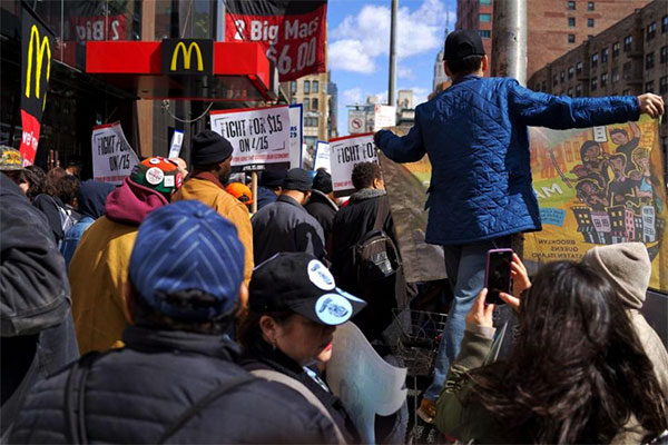Construction specialists join battle for higher least time-based compensation at Manhattan McDonald's rally